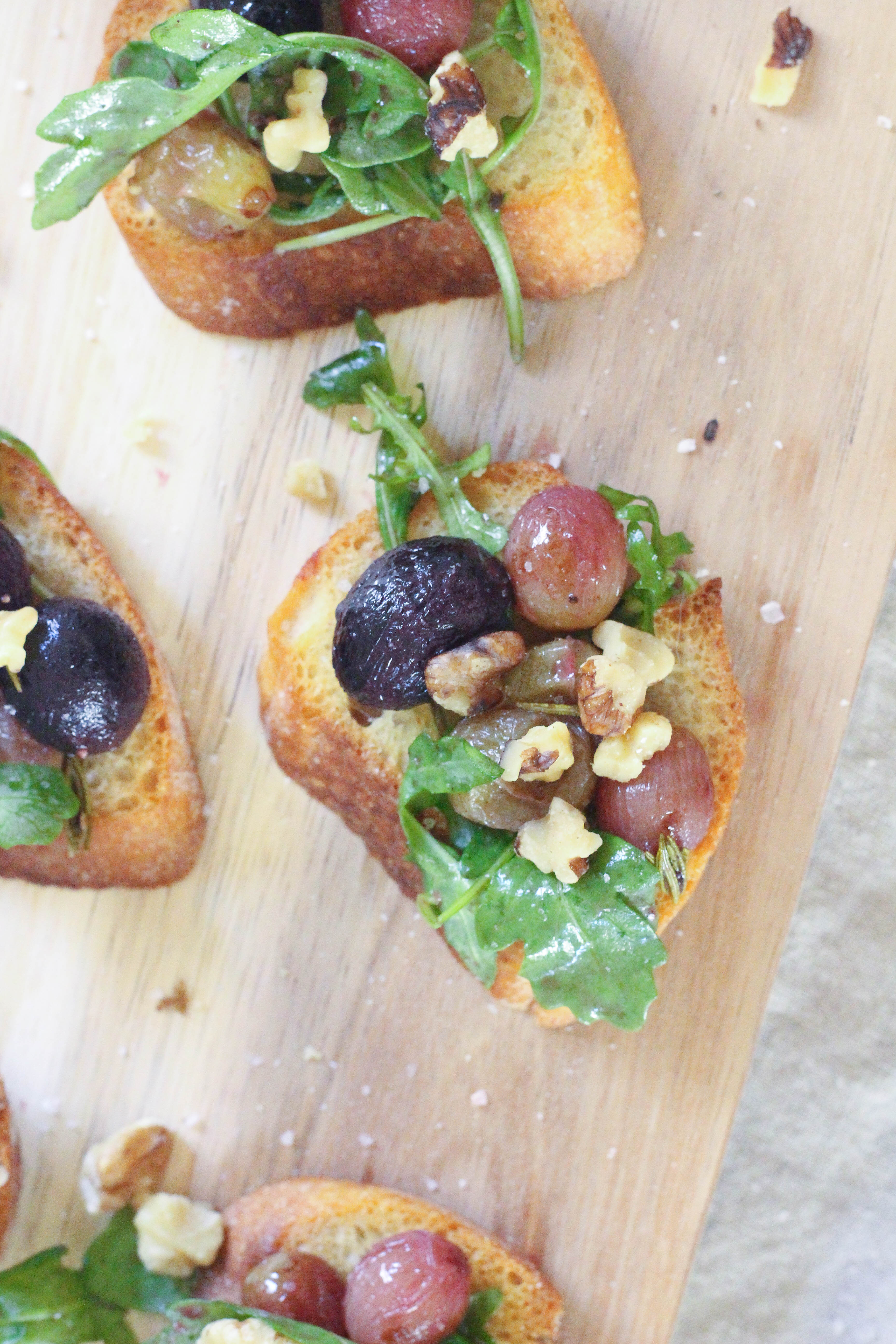 Rosemary roasted grapes on garlic crostini with wilted arugula and ...