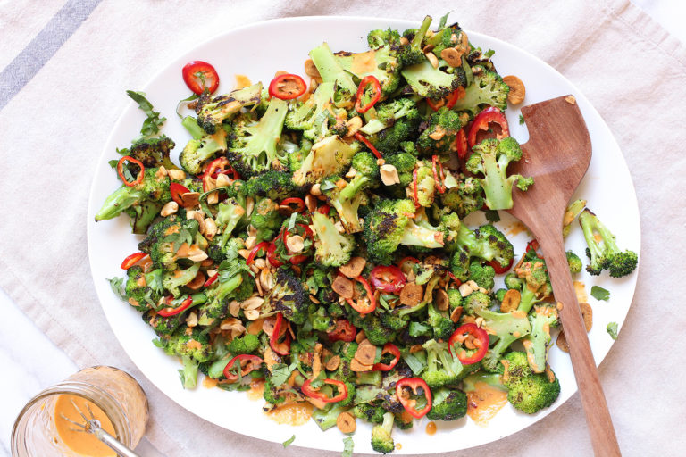 Spicy Broccoli Salad with peanut dressing and crispy garlic chips - vegan & gluten free